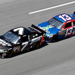 April 17, 2011; Talladega, AL, USA; NASCAR Sprint Cup Series driver Casey Mears (13) drafts Robby Gordon (7) during the Aarons 499 at Talladega Superspeedway.   Mandatory Credit: Derick E. Hingle