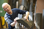 Furniture maker Adrian Swintead polishing an almost finished piece in his Maulden Woods studio, Bedfordshire<br /> CREDIT: Vanessa Berberian for The Wall Street Journal<br /> GURU-SWINSTEAD