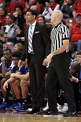 22 December 2015: Dana Ford stands near official Nathan Bemis. Illinois State Redbirds host the Tennessee State Tigers at Redbird Arena in Normal Illinois (Photo by Alan Look)