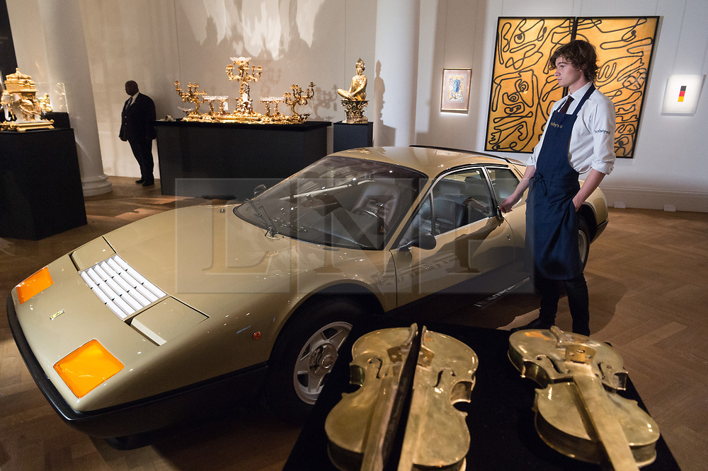 © Licensed to London News Pictures. 12/10/2018. London, UK. A gold 1977 Ferrari 512 BB with an estimate of £350,000 – 450,000 is on show as part of Sotheby's auction dedicated to all things gold. Photo credit: Ray Tang/LNP