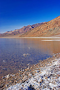 Flooded salt pan at Badwater under the Amargosa Range, Death Valley National Park, California