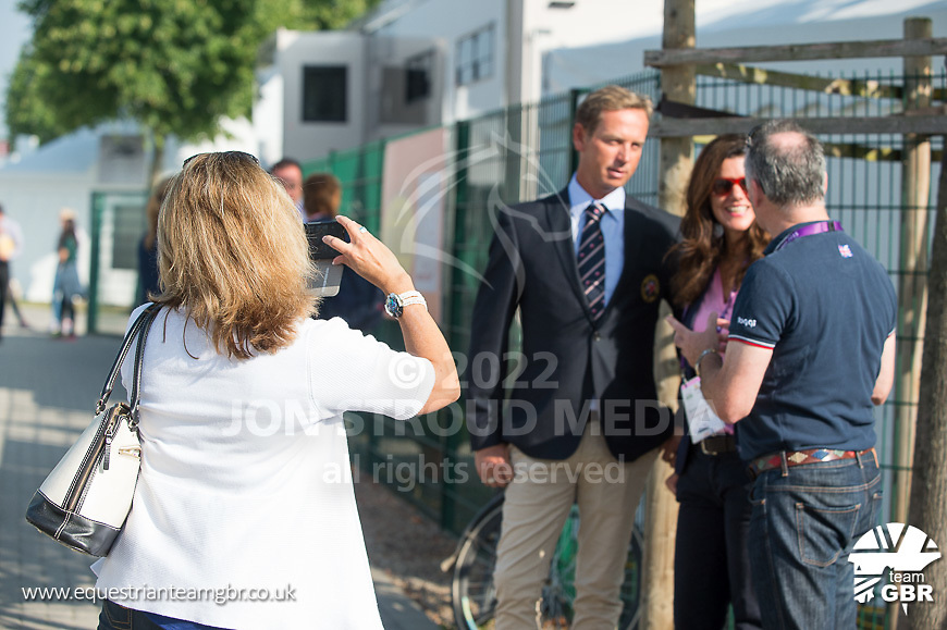 Carl Hester and Jane de la Mare chat to Richard Davison while Nicole Graf-Ussher take a photograph - FEI European Championships 2015 - Aachen, Germany - 11 August 2015