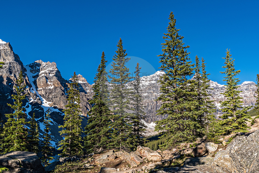 Scenic panoramic view of a blue sky and the snow dusted Fairview Mountain in Banff National Park in Alberta, Canada.