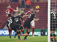 Michael Dawson of Hull City heading the ball away from Alvaro Negredo of Middlesbrough inside the box during the English Premier League match at Riverside Stadium, Middlesbrough. Picture date: December 5th, 2016. Pic Jamie Tyerman/Sportimage
