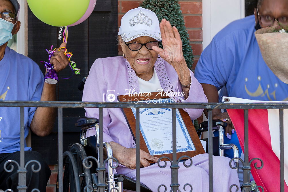 Ethel M. Bowens watches as a parade goes past the Golden Age Nursing Home in Guthrie, Okla. in honor of her 112th birthday and being named the oldest living Oklahoman on Saturday, Aug. 21, 2021. Photo by Alonzo J. Adams.
