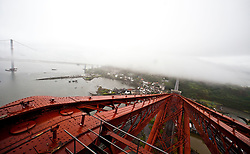 The Forth Bridge, from the platform on the top of the North  tower cantilever structure. The Forth Bridge is a cantilever railway bridge over the Firth of Forth in the east of Scotland, to the east of the Forth Road Bridge, and connects Scotland's capital city, Edinburgh, with Fife, leaving the Lothians at Dalmeny and arriving in Fife at North Queensferry..