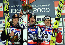 Gregor Schlierenzauer of Austria placed second, Wolfgang Loitzl of Austria became a World Champion and Simon Ammann placed third at Normal Hill Individual Ski jumps at FIS Nordic World Ski Championships Liberec 2008, on February 21, 2009, in Jested, Liberec, Czech Republic. (Photo by Vid Ponikvar / Sportida)