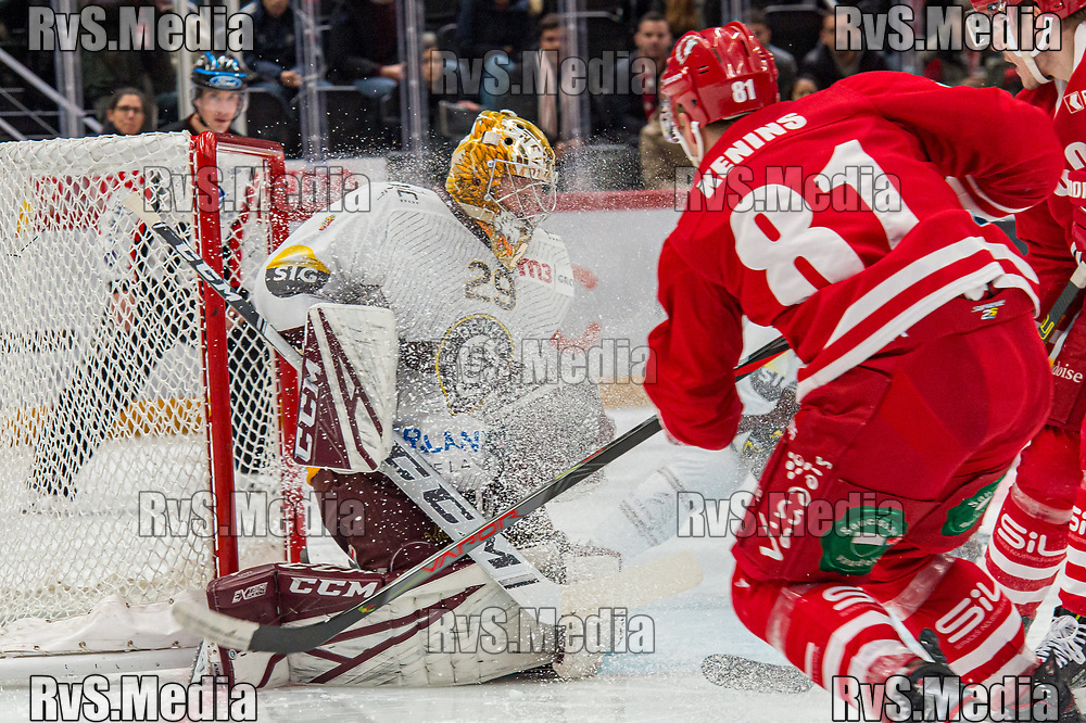 LAUSANNE, SWITZERLAND - NOVEMBER 23: #81 Ronalds Kenins of Lausanne HC tries to score against #29 Goalie Robert Mayer of Geneve-Servette HC during the Swiss National League game between Lausanne HC and Geneve-Servette HC at Vaudoise Arena on November 23, 2019 in Lausanne, Switzerland. (Photo by Robert Hradil/RvS.Media)