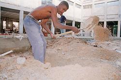 Construction worker in Havana Cuba working on the restoration of the Fine Art Museum   Museo de Bellas Artes,