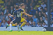 Burton Albion midfielder Ben Fox (12) goes past Southend United defender John White (48) during the EFL Sky Bet League 1 match between Southend United and Burton Albion at Roots Hall, Southend, England on 22 April 2019.