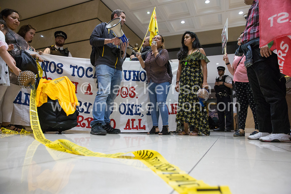 London, UK. 1 June, 2019. Members of the United Voices of the World (UVW) and Independent Workers of Great Britain (IWGB) grassroots trade unions protest inside the DoubleTree Hilton Hotel in solidarity with Dalia Quinonez Guerrero (c), a former cleaner from whom wages were withheld. The protest was previously arranged to have taken place outside Chanel but arrangements were changed after the global fashion chain agreed to pay its cleaners the London Living Wage at its stores.
