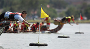 SHOT 7/29/2007 - Mongol Wolves flag catcher Selenge Suhbat (left), 19, of Denver reaches out for the flag during a very tight race against Wells Fargo. The sport of Dragon boat racing is over 2000 years old and features teams of 18 paddlers - nine men and nine women plus someone to steer the boat - all rowing in sync to the beat of a drum and racing to a flag 200 meters away on Sloan's Lake in Denver, Co. Founded in 2001 to celebrate Denver?s rich Asian Pacific American culture, the Colorado Dragon Boat Festival has become the region?s fastest growing and most acclaimed new festival. Festival-goers get to explore the Asian culture through demonstrations, crafts, shopping, eating, and the growing sport of dragon boat racing. .(Photo by Marc Piscotty / © 2007)