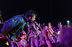 © Licensed to London News Pictures. 13/06/2015. Isle of Wight, UK.   Blur performing live at Isle of Wight Festival 2015, Day 3 Saturday,headlining the main stage.  In this picture - Damon Albarn.   Headline acts include The Prodigy, Blur and Fleetwood Mac.   Photo credit : Richard Isaac/LNP