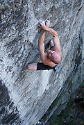"""Dave Kennedy climbing """"Catch and Release"""" 5.13b, at The Lost World, Sonora Pass, Stanislaus National Forest, California"""