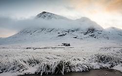 Snow covered winter landscape of Buachaille Etive Mor  in Glen Coe in Scottish Highlands, Scotland, UK