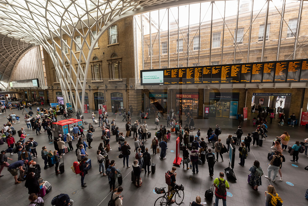 © Licensed to London News Pictures. 29/05/2021. London, UK. Passengers wait for trains at Kings Cross St Pancras train  station to get away for the Bank Holiday Weekend. Photo credit: London News Pictures
