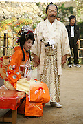 Samurai and wife in traditional clothes. Himeji Castle, Himeji, Japan