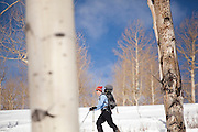 Backcountry skier Emily Miller catches turns through an open aspen grove in Uncompahgre National Forest, Colorado.