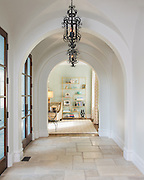 White archway in a Mediterranean style house. Dallas Texas architectural, real estate photography. Interior design and Construction photography services
