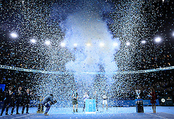 Ticker tape fall as Andy Murray poses with the trophy after winning the championship during day eight of the Barclays ATP World Tour Finals at The O2, London.