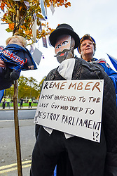 © Licensed to London News Pictures. 05/11/2019. LONDON, UK.  A Remain supporter, with an effigy of Guy Fawkes, protests outside the Houses of Parliament.  Inside, MPs are making their final statements on the day before Parliament is dissolved ahead of the General Election on 12 December, where each parties stance on Brexit will have a significant affect on the voting.  Photo credit: Stephen Chung/LNP