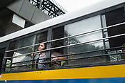 Mumbai, India, 24 sept 2016, A girl is taking a breath through the window of a bus