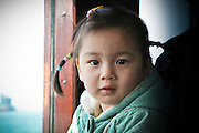 A young girl takes a ride on a ferry in Hong Kong
