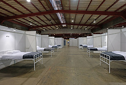 JOHANNESBURG, SOUTH AFRICA - APRIL 25: A general ward of quarantine beds at the Nasrec quarantine site currently under construction. With isolation units, consultation areas, ICU capabilitiies, medical facilities, power points, drainage and ablutions the quarantine site has a total bed capacity of 2300 on April 25, 2020 in Johannesburg South Africa. Under pressure from a global pandemic. President Ramaphosa declared a 21 day national lockdown extended by another two weeks, mobilising goverment structures accross the nation to combat the rapidly spreading COVID-19 virus - the lockdown requires businesses to close and the public to stay at home during this period, unless part of approved essential services. (Photo by Dino Lloyd)