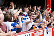 Queens Park Rangers fans celebrate the equaliser by QPR (score1-1)  during the EFL Sky Bet Championship match between Brentford and Queens Park Rangers at Griffin Park, London, England on 21 April 2018. Picture by Andy Walter.