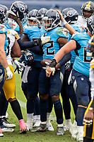 NASHVILLE, TN - OCTOBER 25:  Derrick Henry #22 of the Tennessee Titans is congratulated by teammates after scoring a touchdown in the second half of a game against the Pittsburgh Steelers at Nissan Stadium on October 25, 2020 in Nashville, Tennessee.  The Steelers defeated the Titans 27-24.  (Photo by Wesley Hitt/Getty Images) *** Local Caption *** Derrick Henry