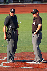 29 July 2016: Umpires Mike Fichter an Stacey Dunbar during a Frontier League Baseball game between the Lake Erie Crushers and the Normal CornBelters at Corn Crib Stadium on the campus of Heartland Community College in Normal Illinois