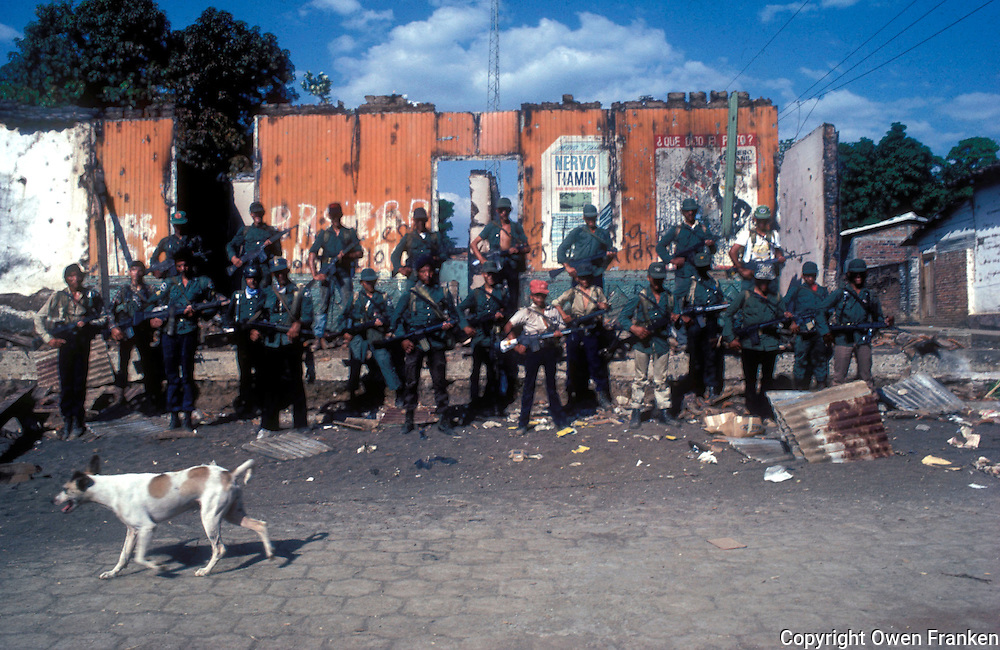 Class portrait of FMLN guerillas in El Salvador, after they attacked a village<br /> during the 1982 civil war - Photograph by Owen Franken