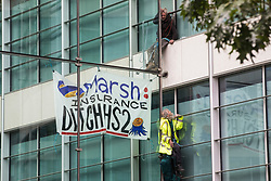 Two climate activists from HS2 Rebellion scale the Tower Place West building in the City of London in protest against the involvement of insurance company Marsh in the HS2 high-speed rail project on 2nd September 2021 in London, United Kingdom. Marsh insure subcontractors working on HS2.