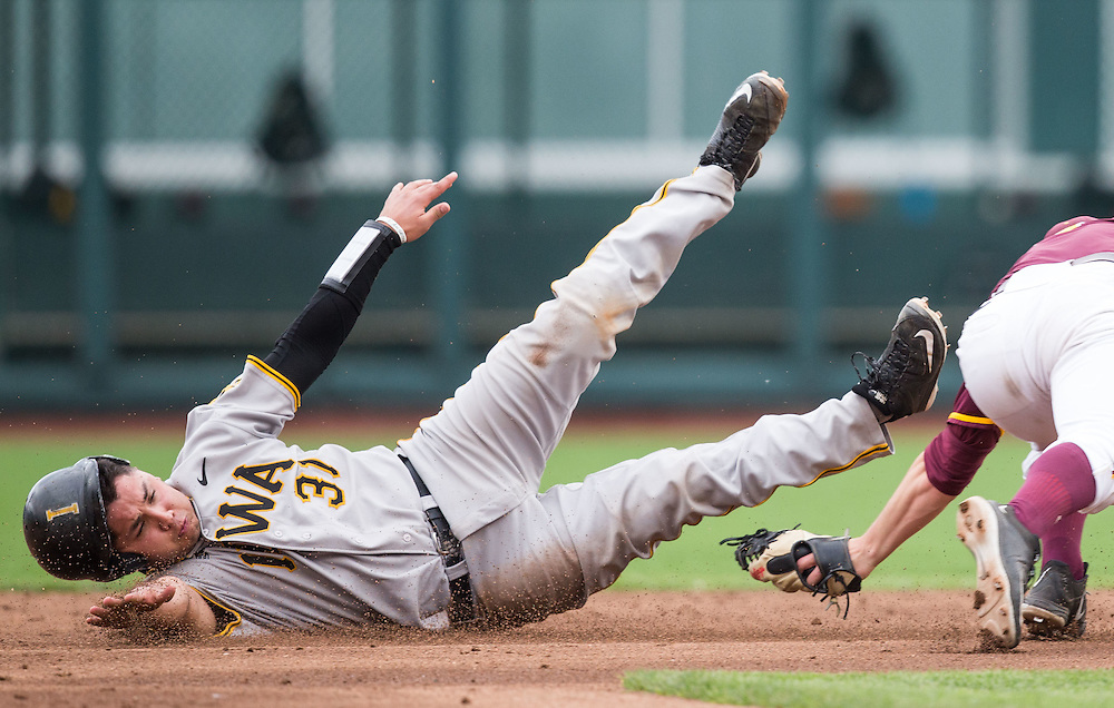 Omaha, Nebraska --<br /> <br /> Iowa's Daniel Aaron Moriel steals second after beating the tag by Minnesota shortstop Luke Pettersen in the third inning of their Big Ten Conference Baseball Tournament game at TD Ameritrade Park on Wednesday, May 25, 2016, in Omaha.<br /> <br /> (MATT DIXON/THE WORLD-HERALD)
