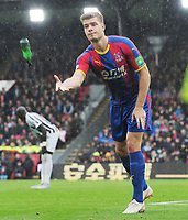 Football - 2018 / 2019 Premier League - Crystal Palace vs. Newcastle United<br /> <br /> Alexander Sorloth of Palace removes a bottle from the pitch after it was thrown from the Newcastle supporters end, at Selhurst Park.<br /> <br /> COLORSPORT/ANDREW COWIE