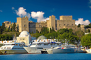 The 14th century medieval palace of the Grand Master of the Kinights of St John with the archaic harbour below, Rhodes, Greece. UNESCO World Heritage Site .<br /> <br /> Visit our GREEK HISTORIC PLACES PHOTO COLLECTIONS for more photos to download or buy as wall art prints https://funkystock.photoshelter.com/gallery-collection/Pictures-Images-of-Greece-Photos-of-Greek-Historic-Landmark-Sites/C0000w6e8OkknEb8