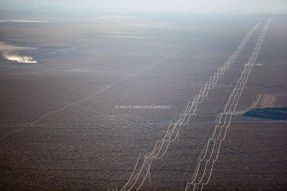 Hydroelectric power lines running across desert; the Hoover Dam generates 2,080 megawatts of electricity per year that is distributed by these power lines throughout Arizona, Nevada, and parts of California.