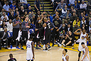 LA Clippers center Marreese Speights (5) celebrates with the bench after making a basket over Golden State Warriors forward Andre Iguodala (9) at Oracle Arena in Oakland, Calif., on February 23, 2017. (Stan Olszewski/Special to S.F. Examiner)