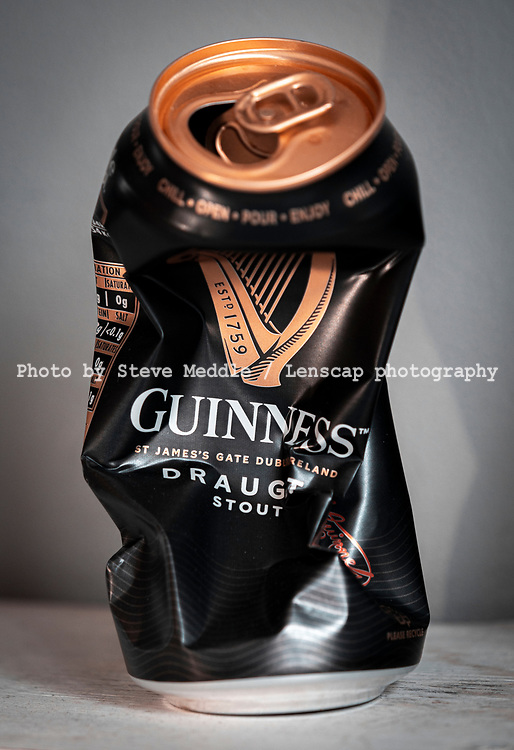 London, England - April  25, 2020: Crushed Guinness Can, Guinness is brewed at St Jame's Gate, Dublin, Ireland, Introduced in 1759 by Arthur Guinness as a Irish Dry Stout.