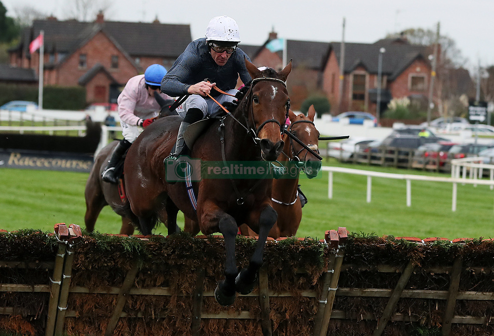 Just Janice ridden by Davy Russell clears the last on the way to winning the Lough Construction Ltd. Irish EBF Mares Novice Hurdle during day one of the Down Royal festival at Down Royal racecourse.