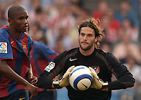 Atletico de Madrid's goalie Leo Franco challenged by Barcelona's Samuel Eto'o during the match. Atletico de Madrid v Barcelona. Spanish League. Madrid September 19, 2004. Photo Alvaro Hernandez Graffiti