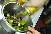 Dressing a salad