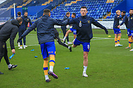 Ollie Clarke of Mansfield Town (8) in the warm up during the The FA Cup match between Mansfield Town and Dagenham and Redbridge at the One Call Stadium, Mansfield, England on 29 November 2020.