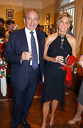 MR & MRS PHILIP HARARI at a an exhibition of prints by art dealer Martin Summers held at 73 Glebe Place, London on 29th June 2004.