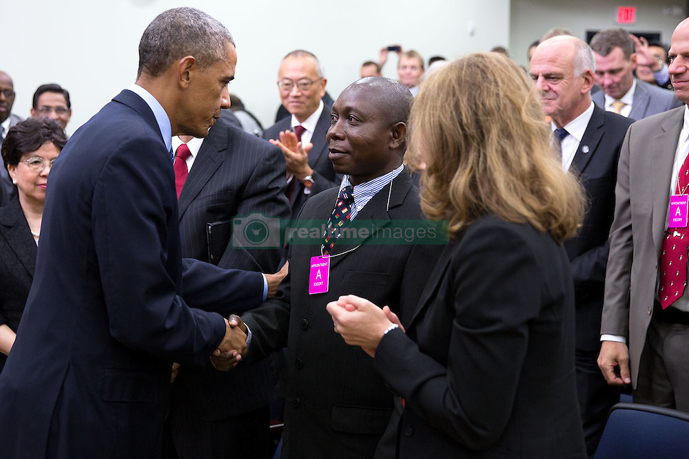 President Barack Obama greets Ebola survivor Dr. Melvin Korkor of Liberia after delivering remarks at the Global Health Security Agenda Summit in the Eisenhower Executive Office Building South Court Auditorium, Sept. 25, 2014. Health and Human Services Secretary Sylvia Mathews Burwell, stands at right. (Official White House Photo by Pete Souza)<br /> <br /> This official White House photograph is being made available only for publication by news organizations and/or for personal use printing by the subject(s) of the photograph. The photograph may not be manipulated in any way and may not be used in commercial or political materials, advertisements, emails, products, promotions that in any way suggests approval or endorsement of the President, the First Family, or the White House.