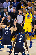 Golden State Warriors forward Andre Iguodala (9) shoots a three pointer against the Minnesota Timberwolves at Oracle Arena in Oakland, Calif., on January 25, 2018. (Stan Olszewski/Special to S.F. Examiner)