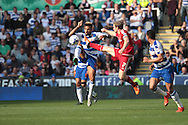 Middlesbrough midfielder Grant Leadbitter tackles Reading midfielder Daniel Williams during the Sky Bet Championship match between Reading and Middlesbrough at the Madejski Stadium, Reading, England on 3 October 2015. Photo by Jemma Phillips.