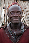 A traditionally dressed Himba chief at his home in Okapembambu village, northwestern Namibia.