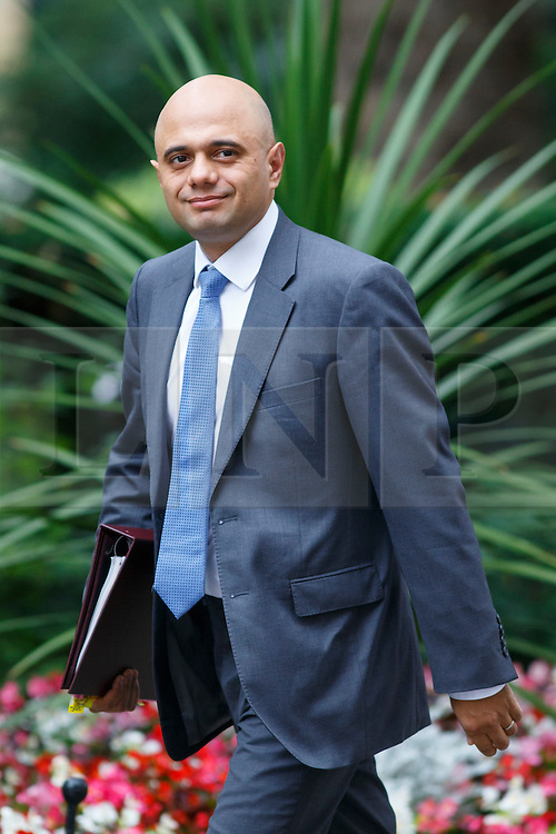 © Licensed to London News Pictures. 14/07/2015. London, UK. Business Secretary, Sajid Javid attending to a cabinet meeting in Downing Street on Tuesday, July 14, 2015. Photo credit: Tolga Akmen/LNP