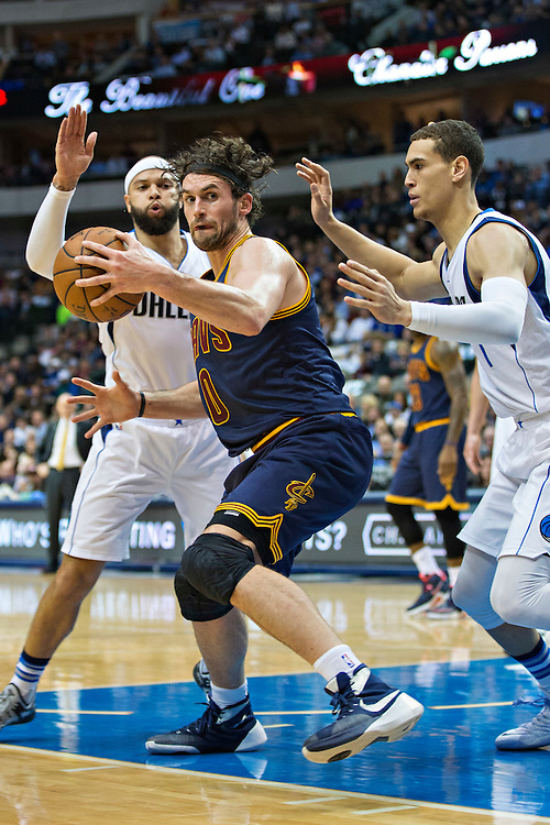 DALLAS, TX - JANUARY 12:  Kevin Love #0 of the Cleveland Cavaliers with the ball under the basket while being guarded by Dwight Powell #7 and Deron Williams #8 of the Dallas Mavericks at American Airlines Center on January 12, 2016 in Dallas, Texas.  NOTE TO USER: User expressly acknowledges and agrees that, by downloading and or using this photograph, User is consenting to the terms and conditions of the Getty Images License Agreement.  The Cavaliers defeated the Mavericks 110-107.  (Photo by Wesley Hitt/Getty Images) *** Local Caption *** Kevin Love; Deron Williams; Dwight Powell